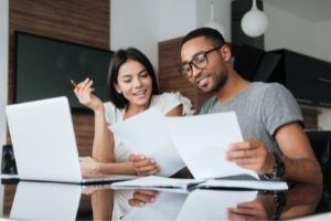 Two people look into the Jumbo Loan Limit Texas